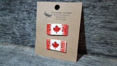 Pair of maple leaf buttons