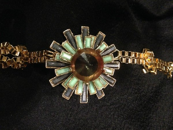 Bracelet with Gold Tone Knotted Chain and Beautiful Center Stones in Starburst Setting