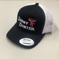 BLK/WHT MESH TRUCKER HAT WITH NEON PINK/WHITE LOGO.