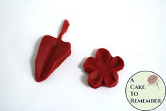 SIlicone mold to make a small flower and leaf, fondant or gumpaste mold. Silicone mold for polymer clay, resin, UTEE, and isomalt. M5105