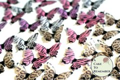 24 animal print edible butterflies for cake decorating, cookies, cupcakes, cake pops. Wafer paper butterflies, wedding cake toppers.