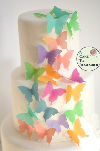 24 watercolor edible wafer paper butterflies for cake decorating, cupcake decorating and cookie decorating. Wedding cake edible butterflies