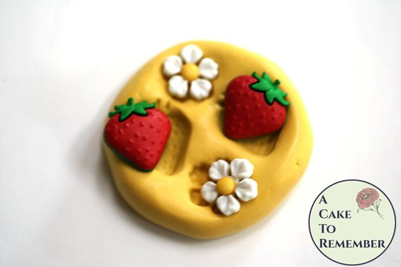 Small strawberry silicone rubber mold for candy or soap embeds M5186