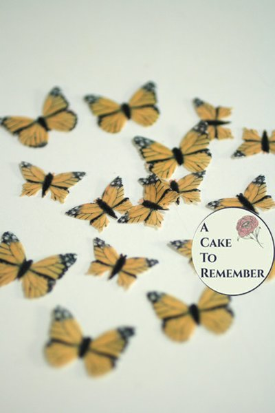 48 small edible monarch butterflies for cake decorating, cookies, cupcake decorating, cake pops. Wafer paper butterflies, wedding cake toppers.