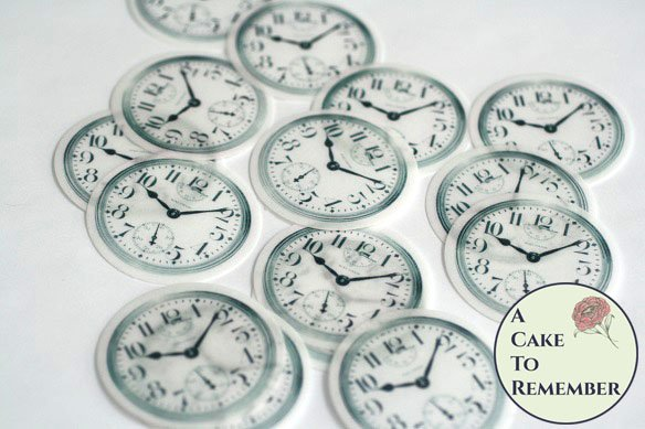 """12 2"""" pocketwatch clock faces for Alice in Wonderland cakes and chocolate covered cookies."""