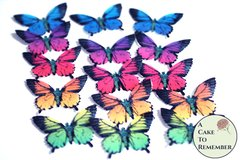 """15 bright rainbow wafer paper cupcake topper edible butterflies. 2"""" wide."""