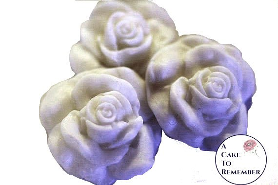 Molded fondant edible roses for cake decorating or cupcake toppers, sugar roses