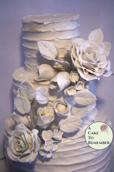 Gumpaste floral arrangement for wedding cakes. White edible flowers for a cake topper. Enough for a small cascade or one large group.