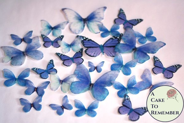 26 blue butterfly wedding cake decorations for a spring wedding cake or a rustic wedding cake. Edible butterflies, bridal shower ideas.
