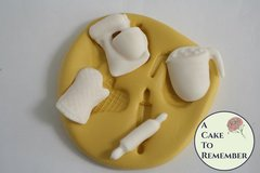 Silicone mold to make kitchen items including a mixer, rolling pin, measuring cup and oven mitt. M5081