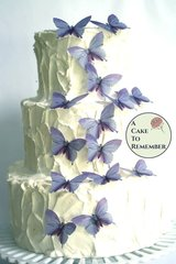 "15 lavender color romantic cake topper edible butterflies. 2"" wide."