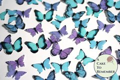 48 small teal, blue and purple edible butterflies for cake decorating and cupcake toppers