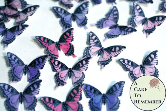 36 pink and purple edible butterflies for baby shower cakes, princes cakes, cake decorating, cookies, cupcake decorating, cake pops.