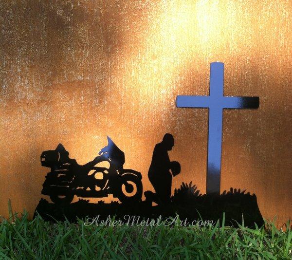 biker kneeling at the cross metal art