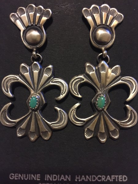 Signed MC antique finish large dangle stamped earrings.