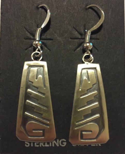 Hopi sterling silver relief dangle earrings.
