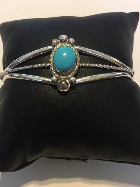 Oval shape turquoise & sterling silver navajo bracelet.