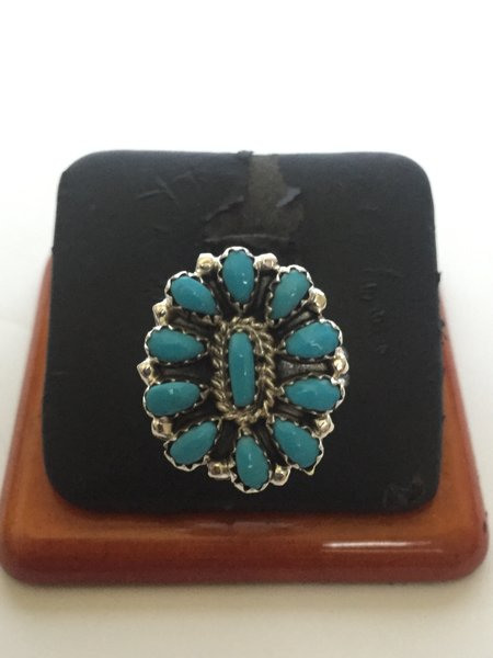 Sleeping beauty turquoise & sterling squash blossom ring signed.