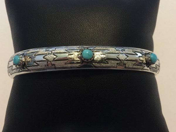 Signed Navajo bracelet. Etched Sterling silver & turquoise.