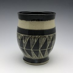 Hand carved tumbler