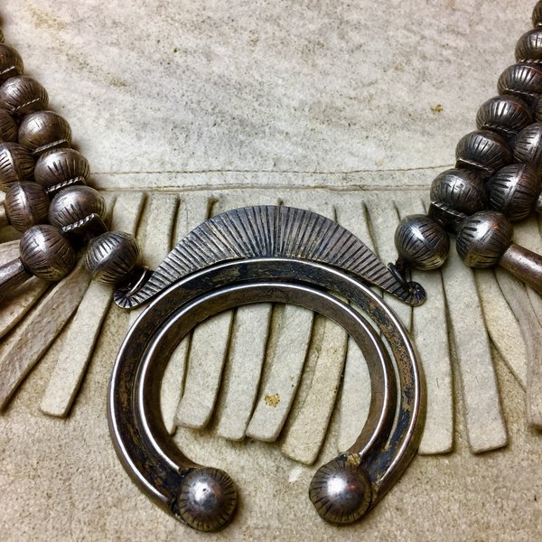 1920s RARE INGOT SILVER 20 BLOSSOM CHISELED BENCH BEAD & NAJA SQUASH BLOSSOM NECKLACE ATELIER RESTRUNG ON AMERICAN DEERSKIN.