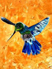 Hummingbird In Flight