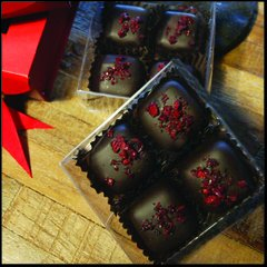 Organic cherries sprinkled over coconut milk caramels, enrobed in 85% cacao. Three boxes per order.