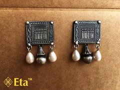 Silver tribal carved studs