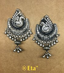 Silver carved peacock earring