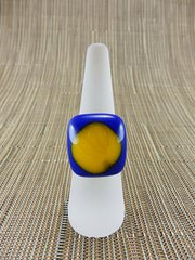Blue glass ring with yellow centre