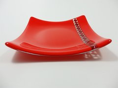 Dark red glass medium sized curved plate with twister glass inset