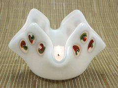 White glass bowl/candle holder with small red/green swirls