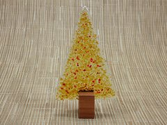 Amber glass textured Christmas tree with hints of red in Jarrah stand