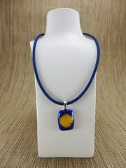 Blue glass pendant with yellow centre