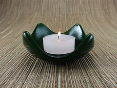 Dark green glass small curved candle holder