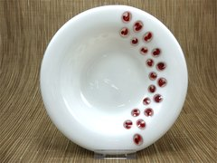 White glass bowl with red swirl spot design