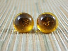 Amber coloured (transparent) glass stud earrings