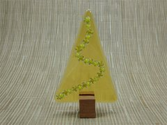 Amber glass Christmas tree with a string of green/gold swirls in Jarrah stand
