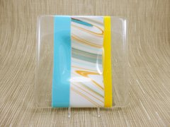 Blue/yellow glass medium sized square centred plate