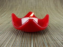 Dark red glass small curved candle holder