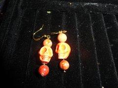 gold plated Orange skull w/glass beads