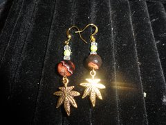 gold plated glass brown beads/finest crystals/marijuana leaf