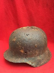 German Soldiers M40 Helmet green paint remains,Army decal,blast damage recovered the Stalingrad battlefield 1942-1943 in Russia