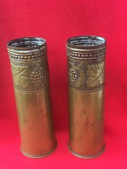 Matching pair British 18 pounder shell cases trench art well done leaf and grape design around the top both cases dated 1916 and 1917 found on The Somme battlefield