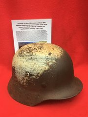 German SS Nord Division soldiers M40 helmet single decal with white camouflage paintwork,liner ring recovered in June 2014 from a river bed with recovery picture in North Karelira the battlefield in Finland 1941-1944