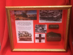 Glass framed Track link section with blast damage and section of track pin from German Tiger 1 Tank recovered from the Falaise Pocket in Normandy from the 1944 Summer battlefield