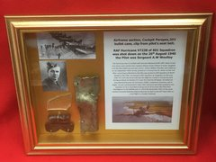 Glass framed Airframe section,Perspex,303 case,seat belt clip from RAF Hurricane V7238 of 601 Squadron was shot down on the 26th August 1940 and crashed at Great Totham in Essex