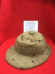 RAF Tropical Helmet Owned by Spitfire Pilot J.Cables used in training camp in South Africa dated 1942 he flew with the Desert Airforce and it has swastika kills on the inside