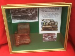 Glass framed Track link section with blast damage and pin hole from German Tiger 1 Tank recovered from the Falaise Pocket in Normandy from the 1944 Summer battlefield