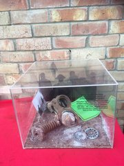 British soldiers gas mask remains recovered from Dunkirk beach in perspex display case with sand and wood from the Beach a very nice rare relic from the famous pocket in 1940 and the battle of France